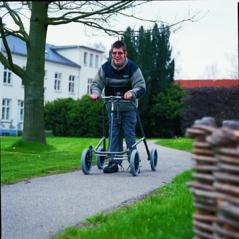 Hand steered outdoor walker. Great gait trainer.
